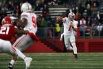 Ohio State quarterback Justin Fields (1) passes against Rutgers during the first half of an NCAA college football game Saturday, Nov. 16, 2019, in Piscataway, N.J. (AP Photo/Adam Hunger)