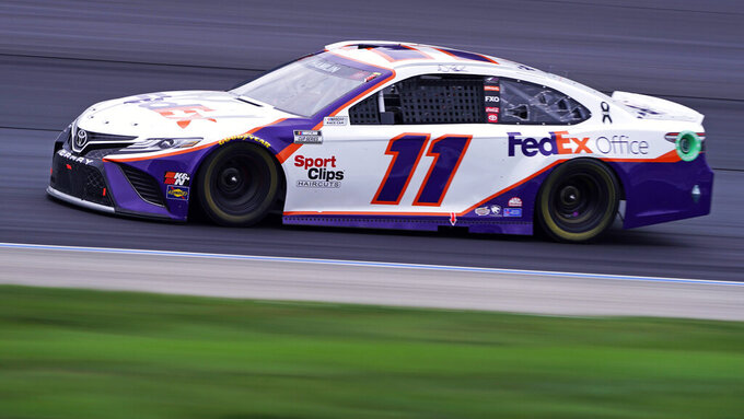 Denny Hamlin competes at a NASCAR Cup Series auto race, Sunday, July 18, 2021, in Loudon, N.H. (AP Photo/Charles Krupa)