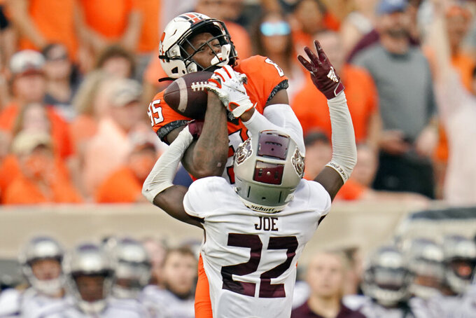 Oklahoma State wide receiver Jaden Bray (85) catches a pass in front of Missouri State cornerback Lemondre Joe (22) in the first half of an NCAA college football game, Saturday, Sept. 4, 2021, in Stillwater, Okla. (AP Photo/Sue Ogrocki)