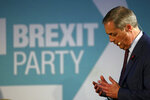 Brexit Party leader Nigel Farage speaks at a meeting to introduce his party's Parliamentary Candidates (PPC) ahead of the upcoming general election, in Westminster, London, Monday Nov. 4, 2019. Britain's election campaign heated up Sunday with Prime Minister Boris Johnson saying he would apologize to Conservatives for failing to take the U.K. out of the European Union by Oct. 31 and Brexit Party leader Nigel Farage saying he won't personally run for a seat in Parliament. (Aaron Chown/PA via AP)