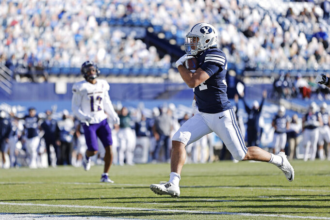 BYU linebacker Kavika Fonua (34) runs in for a touchdown in the second quarter against North Alabama during an NCAA college football game Saturday, Nov. 21, 2020, in Provo, Utah. (AP Photo/Jeff Swinger, Pool)