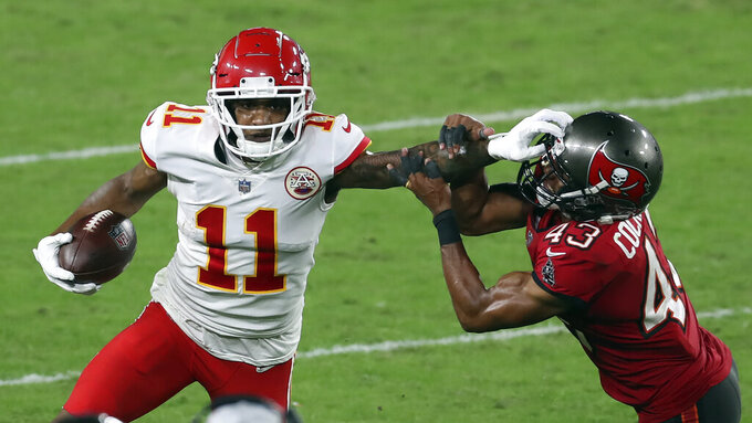 Kansas City Chiefs wide receiver Demarcus Robinson (11) stiff arms Tampa Bay Buccaneers defensive back Ross Cockrell (43) after a catch during the second half of an NFL football game Sunday, Nov. 29, 2020, in Tampa, Fla. (AP Photo/Mark LoMoglio)
