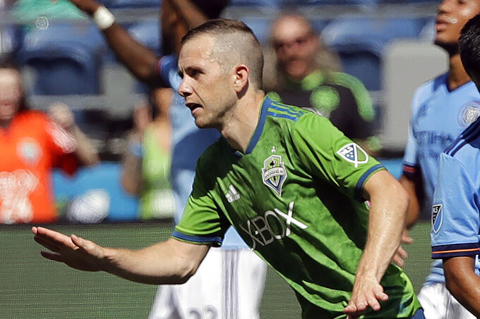 FILE - In this July 29, 2018, file photo, Seattle Sounders midfielder Harry Shipp reacts after scoring a goal against New York City FC during the second half of an MLS soccer match in Seattle. When Major League Soccer and its players came to agreement on a new collective bargaining agreement back in February, there was a genuine feeling of accomplishment on both sides. Those pre-pandemic positive vibes are now gone, at least in how the players feel toward the league and ownership. (AP Photo/Ted S. Warren, File)