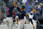 Boston Red Sox's Christian Arroyo, center, celebrates with teammate Rafael Devers, left, as New York Yankees catcher Gary Sanchez, right, looks away during the second inning of a baseball game Friday, July 16, 2021, in New York. (AP Photo/Frank Franklin II)