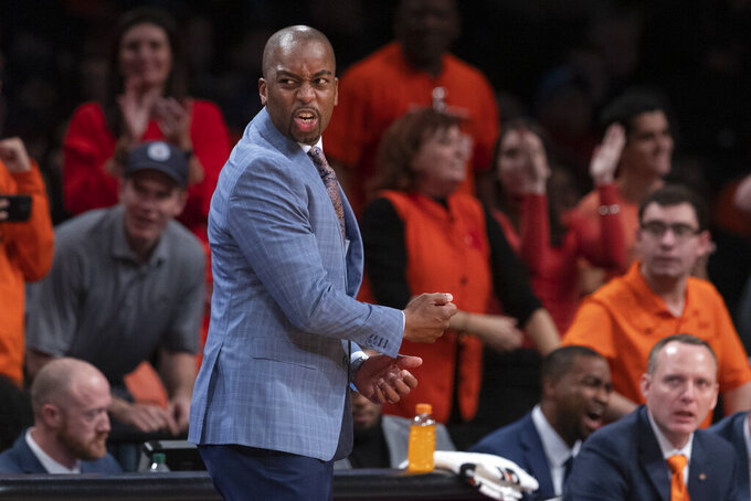 Oklahoma State head coach Mike Boynton Jr. reacts during the first half of an NCAA college semi final basketball game against the Syracuse in the NIT Season Tip-Off tournament, Wednesday, Nov. 27, 2019, in New York. (AP Photo/Mary Altaffer)