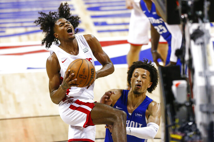 Houston Rockets' Jalen Green drives to the basket against Detroit Pistons' Cade Cunningham during the second half of an NBA summer league basketball game Tuesday, Aug. 10, 2021, in Las Vegas. (AP Photo/Chase Stevens)