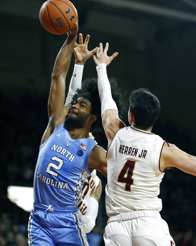 Boston College's Chris Herren Jr. (4) blocks a shot by North Carolina's Coby White (2) during the second half of an NCAA college basketball game in Boston, Tuesday, March 5, 2019. (AP Photo/Michael Dwyer)