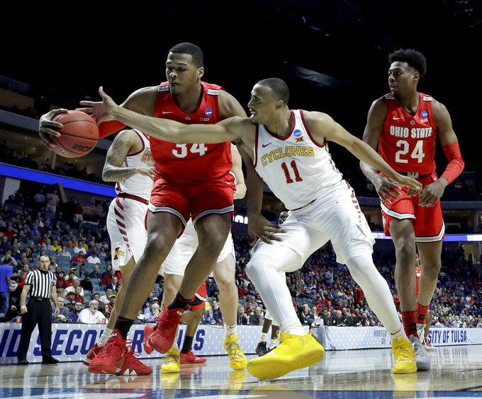 Iowa State's Talen Horton-Tucker (11) tries to steal the ball from Ohio State's Kaleb Wesson (34) during the first half of a first round men's college basketball game in the NCAA Tournament Friday, March 22, 2019, in Tulsa, Okla. (AP Photo/Charlie Riedel)