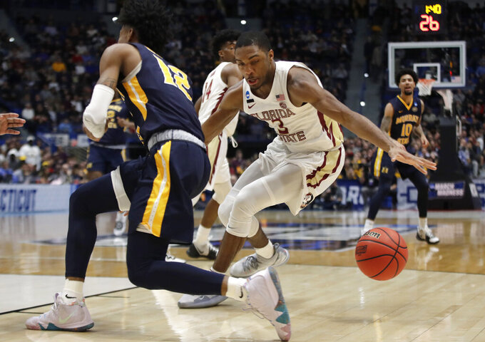 Florida State's Trent Forrest (3) steals the ball from Murray State's Ja Morant (12) during the first half of a second round men's college basketball game in the NCAA Tournament, Saturday, March 23, 2019, in Hartford, Conn. (AP Photo/Elise Amendola)