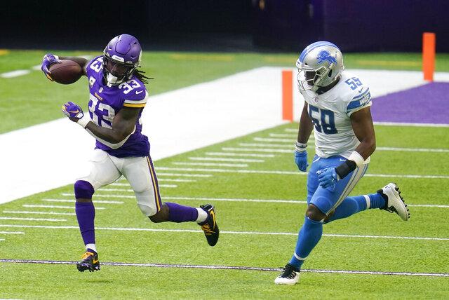 Minnesota Vikings running back Dalvin Cook (33) runs from Detroit Lions linebacker Reggie Ragland, right, during the second half of an NFL football game, Sunday, Nov. 8, 2020, in Minneapolis. (AP Photo/Jim Mone)