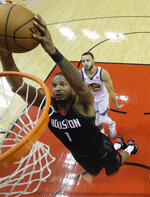 Houston Rockets forward Trevor Ariza (1) scores past Golden State Warriors guard Stephen Curry (30) in the first half during Game 2 of the NBA Western Conference Finals, Wednesday, May 16, 2018, in Houston. (AP Photo/David J. Phillip)