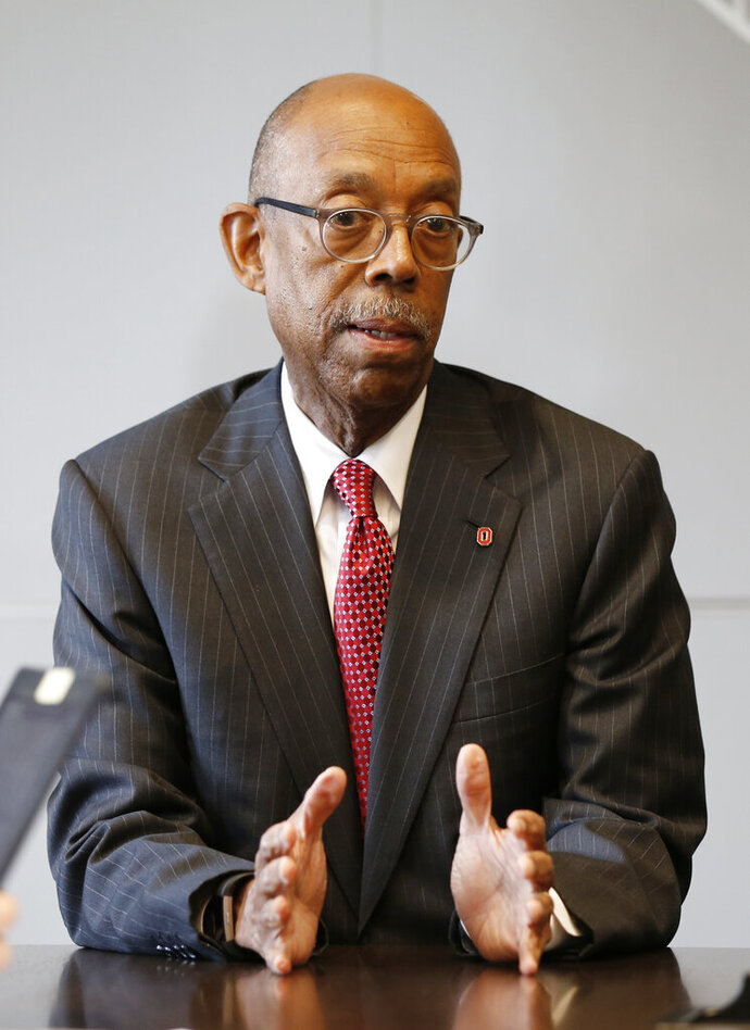 FILE - In this May 17, 2019, file photo, Ohio State University president Michael Drake answers questions during an interview in Columbus, Ohio. The University of California system has named Drake to replace Janet Napolitano and become its first Black president. A physician, Drake was unanimously approved Tuesday, July 7, 2020, by the Board of Regents. (AP Photo/Jay LaPrete, File)