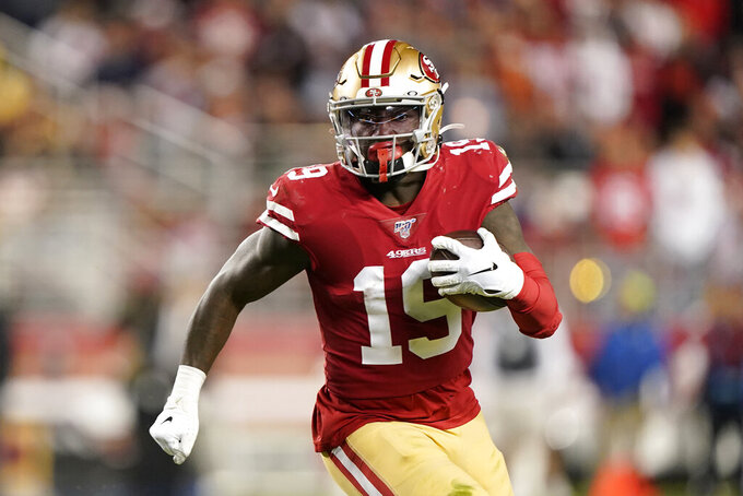 San Francisco 49ers wide receiver Deebo Samuel runs with the ball against the Los Angeles Rams during the first half of an NFL football game in Santa Clara, Calif., Saturday, Dec. 21, 2019. (AP Photo/Tony Avelar)