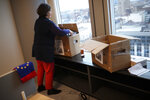 British European Parliament member of the Group of the Progressive Alliance of Socialists and Democrats Judith Kirton-Darling packs some of her belongings at her office at the European Parliament in Brussels, Monday, Jan. 27, 2020. The U.K. is due to leave the EU on Friday, the first nation in the bloc to do so. It then enters an 11-month transition period in which Britain will continue to follow the bloc's rules while the two sides work out new deals on trade, security and other areas. (AP Photo/Francisco Seco)