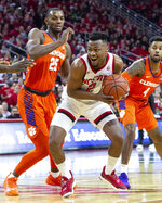 North Carolina State's Torin Dorn (2) gathers the ball as Clemson's Aamir Simms (25) defends during the first half of an NCAA college basketball game in Raleigh, N.C., Saturday, Jan. 26, 2019. (AP Photo/Ben McKeown)