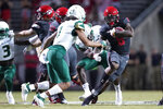 North Carolina State running back Ricky Person Jr. (8) runs the ball whilke South Florida safety Matthew Hill (1) looks to tackle during the first half of an NCAA college football game between North Carolina State and South Florida in Raleigh, N.C., Thursday, Sept. 2, 2021. (AP Photo/Gerry Broome)