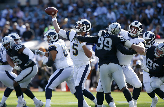 Los Angeles Rams' Blake Bortles throws a pass against the Oakland Raiders during the first half of an NFL preseason football game Saturday, Aug. 10, 2019, in Oakland, Calif. (AP Photo/Rich Pedroncelli)