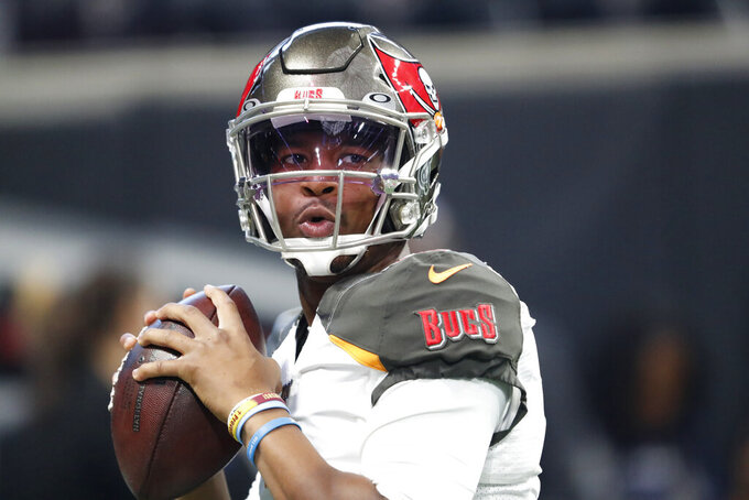 Tampa Bay Buccaneers quarterback Jameis Winston (3) warms up before NFL football game against the Atlanta Falcons, Sunday, Nov. 24, 2019, in Atlanta. (AP Photo/John Bazemore)