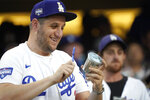 A fan bangs on a miniature trash can as the Houston Astros play the Los Angeles Dodgers during the third inning of a baseball game Tuesday, Aug. 3, 2021, in Los Angeles. (AP Photo/Marcio Jose Sanchez)