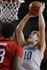 Northwestern's Miller Kopp (10) shoots against Nebraska's Jervay Green (23) during the second half of an NCAA college basketball game in Lincoln, Neb., Sunday, March 1, 2020. (AP Photo/Nati Harnik)