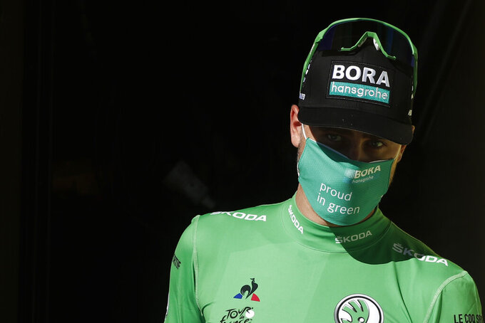 Slovakia's Peter Sagan wearing the best sprinter's green jersey arrives on the podium after the seventh stage of the Tour de France cycling race over 168 kilometers (105 miles), with start in Millau and finish in Lavaur, Friday, Sept. 4, 2020. (Benoit Tessier/Pool via AP)