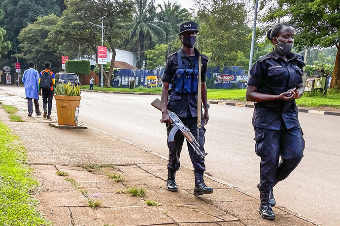 Security forces patrol in Kampala, Uganda Wednesday, Jan. 13, 2021.The United States ambassador to Uganda said Wednesday the embassy has canceled plans to observe the country's tense presidential election on Thursday, citing a decision by electoral authorities to deny accreditation to most members of the observation team.(AP Photo/Jerome Delay)