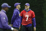 FILE - In this Oct. 26, 2017, file photo, Minnesota Vikings quarterback Case Keenum talks to quarterbacks coach Kevin Stefanski during an NFL walkthrough practice session at Syon House in Syon Park, south west London. Keenum's NFL  journey is reuniting him with a coach who brought out the best in the quarterback. Keenum officially signed his three-year, $18 million contract Tuesday, March 24, 2020, with the Cleveland Browns, who are bringing him in to help Baker Mayfield and give new coach Kevin Stefanski a security blanket in case things don't go as planned. (AP Photo/Matt Dunham, File)