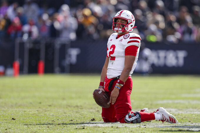 Nebraska quarterback Adrian Martinez (2) falls to his knees after failing to pick up a first down against Purdue during the second half of an NCAA college football game in West Lafayette, Ind., Saturday, Nov. 2, 2019. Purdue defeated Nebraska 31-27. (AP Photo/Michael Conroy)
