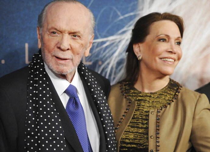FILE - In this Monday, Dec, 10, 2012 file photo, lyricist Herbert Kretzmer and his wife Sybil Sever attend the premiere for