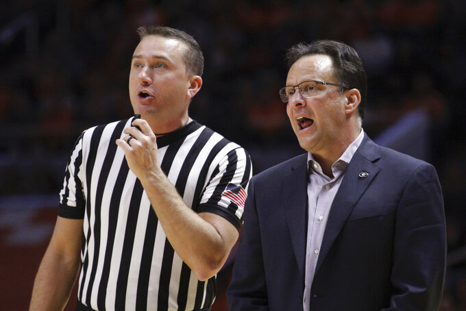 "FILE - In this Jan. 5, 2019, file photo, Georgia head coach Tom Crean speaks with an official in the second half of an NCAA college basketball game against Tennessee, in Knoxville, Tenn. Crean received a jolting welcome to the SEC in Georgia's 90-56 loss at No. 3 Tennessee, reminding the first-year coach his team has ""a long way"" to go entering Wednesday night's game against Vanderbilt.  (AP Photo/Shawn Millsaps, File)"