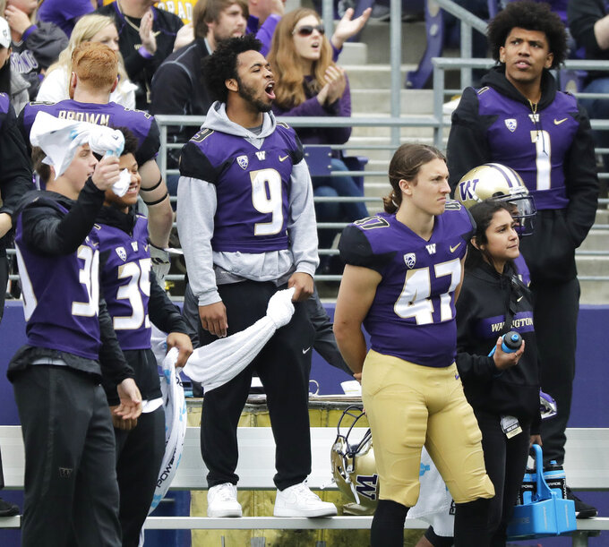Injured Washington running back Myles Gaskin (9) stands on the bench in sweats during the first half of an NCAA college football game against Colorado, Saturday, Oct. 20, 2018, in Seattle. Gaskin did not play in the game. (AP Photo/Ted S. Warren)