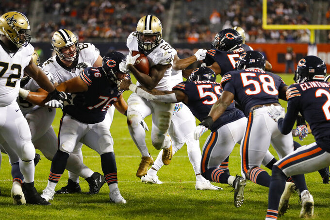 New Orleans Saints running back Latavius Murray (28) runs in for a touchdown between Chicago Bears defensive tackle Abdullah Anderson (76) and inside linebacker Danny Trevathan (59) during the second half of an NFL football game in Chicago, Sunday, Oct. 20, 2019. (AP Photo/Charles Rex Arbogast)