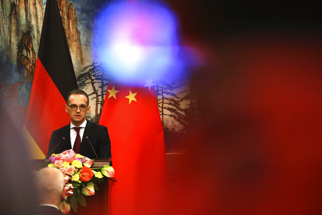 "FILE-In this Nov. 13, 2018 file photo German Foreign Minister Heiko Maas speaks during a joint press conference at the Diaoyutai State Guesthouse in Beijing. China has condemned Germany's decision to suspend its extradition agreement with Hong Kong, accusing Berlin of a ""serious breach of international law."" (AP Photo/Ng Han Guan)"