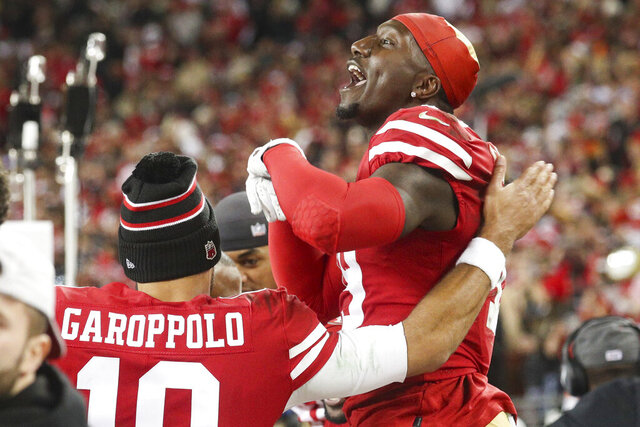 San Francisco 49ers quarterback Jimmy Garoppolo (10) celebrates with wide receiver Deebo Samuel (19) during the NFL NFC Championship football game against the Green Bay Packers, Sunday, Jan. 19, 2020 in Santa Clara, Calif. The 49ers defeated the Packers 37-20. (Margaret Bowles via AP)