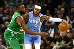 Minnesota Timberwolves guard D'Angelo Russell (0) blocks the reach of Boston Celtics guard Jaylen Brown (7) in the first quarter of an NBA basketball game Friday, Feb. 21, 2020, in Minneapolis. (AP Photo/Andy Clayton-King)