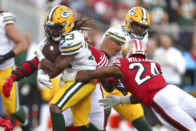 Green Bay Packers running back Aaron Jones (33) runs against the San Francisco 49ers during the first half of an NFL football game in Santa Clara, Calif., Sunday, Sept. 26, 2021. (AP Photo/Jed Jacobsohn)