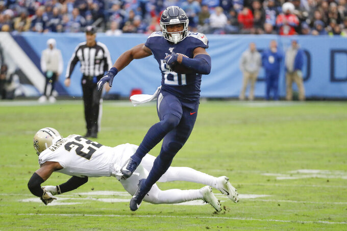Tennessee Titans tight end Jonnu Smith (81) gets past New Orleans Saints defensive back Chauncey Gardner-Johnson (22) as Smith scores a touchdown in the first half of an NFL football game Sunday, Dec. 22, 2019, in Nashville, Tenn. (AP Photo/James Kenney)