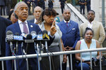 Rev. Al Sharpton, left, speaks at a news conference outside the U.S. Attorney's office, in the Brooklyn borough of New York, Tuesday, July 16, 2019. Gwen Carr, center, mother of chokehold victim Eric Garner is at center, and his widow Esaw Snipes is at right. Federal prosecutors won't bring civil rights charges against New York City police officer Daniel Pantaleo, in the 2014 chokehold death of Garner, a decision made by Attorney General William Barr and announced one day before the five-year anniversary of his death, officials said.  (AP Photo/Richard Drew)