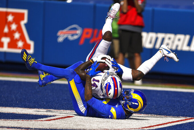 Buffalo Bills' Stefon Diggs, above, catches a pass in the end zone for a touchdown as Los Angeles Rams' Jalen Ramsey defends, during the second half of an NFL football game Sunday, Sept. 27, 2020, in Orchard Park, N.Y. (AP Photo/Adrian Kraus)