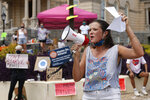 Amelia Wheeler of the United Campus Workers speaks during a