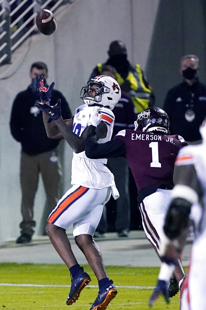 Auburn wide receiver Seth Williams (18) reaches for a 32-yard touchdown reception over the defense of Mississippi State cornerback Martin Emerson Jr. (1) during the second half of an NCAA college football game Saturday, Dec. 12, 2020, in Starkville, Miss. (AP Photo/Rogelio V. Solis)