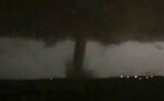 This Oct. 20, 2019 image made from video by Twitter user @AthenaRising shows the tornado in Rockwall, TX. The National Weather Service confirmed a tornado touched down in Dallas on Sunday night, causing structural damage and knocking out electricity to thousands. (@AthenaRising via AP)