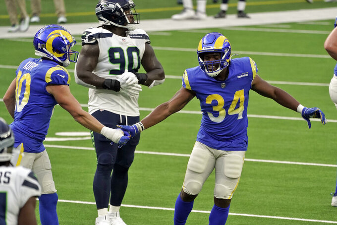 Los Angeles Rams running back Malcolm Brown (34) celebrates after scoring with Los Angeles Rams' Cooper Kupp, left, during the first half of an NFL football game against the Seattle Seahawks Sunday, Nov. 15, 2020, in Inglewood, Calif. (AP Photo/Jae C. Hong)