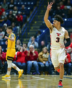 Youngstown State guard Darius Quisenberry (3) celebrates after hitting a 3-point shot during the first half of an NCAA college basketball game against West Virginia, Saturday, Dec. 21, 2019, in Youngstown, Ohio. (AP Photo/David Dermer)