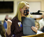 Custer Health Administrator Erin Ourada addresses the Morton County Commission on Thursday, Sept. 10, 2020, in Mandan, N.D. She spoke in favor of a mask mandate, which the commission rejected. Coronavirus infections in the Dakotas are growing faster than anywhere else in the nation, fueling impassioned debates over masks, personal responsibility and freedom after months in which the two states avoided the worst of the pandemic. (Will Kincaid/The Bismarck Tribune via AP)