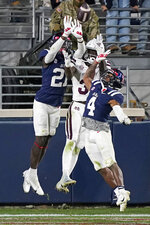 Mississippi defensive backs A.J. Finley (21) and Tylan Knight (4) knock away the end-zone pass to Mississippi State wide receiver Jaden Walley (31) during the second half of an NCAA college football game, Saturday, Nov. 28, 2020, in Oxford, Miss. Mississippi won 31-24. (AP Photo/Rogelio V. Solis)