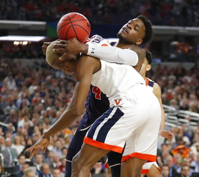 Auburn's Malik Dunbar (4) battles for a rebound against Virginia's Mamadi Diakite during the second half in the semifinals of the Final Four NCAA college basketball tournament, Saturday, April 6, 2019, in Minneapolis. (AP Photo/Jeff Roberson)