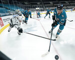 San Jose Sharks right wing Timo Meier (28) works along the boards against Los Angeles Kings right wing Adrian Kempe (9) during the second period of an NHL hockey game Saturday, April 10, 2021, in San Jose, Calif. (AP Photo/Tony Avelar)