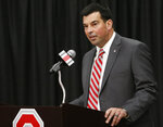 FILE - In this Dec. 4, 2018, file photo, Ryan Day answers questions during a news conference announcing his hiring as NCAA college football head coach at Ohio State, in Columbus, Ohio. The Buckeyes started Wednesday, Feb. 6, 2019, by losing four-star offensive lineman Doug Nester, who flipped to Virginia Tech. The Buckeyes then beat out Southern California for four-star offensive lineman Enokk Vimahi of Kahuku, Hawaii.(AP Photo/Jay LaPrete, File)