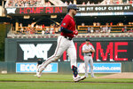 Minnesota Twins' Mitch Garver jogs home on a grand slam off Detroit Tigers pitcher Tyler Alexander, rear, durng the first inning of a baseball game Tuesday, July 27, 2021, in Minneapolis. (AP Photo/Jim Mone)